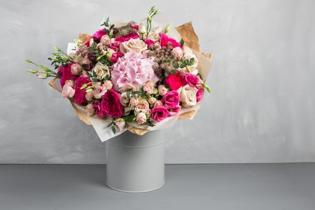 Still life with a bouquet of flowers. the florist put together a beautiful bunch of flowers. Man manual work used different types of flowers and colors. copy space