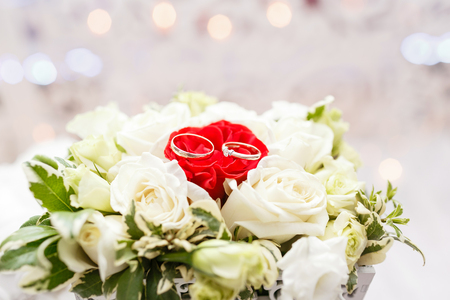 Set of wedding rings in Red and white rose taken closeup. wedding concept. selective focus