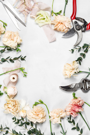 The florist desktop with working tools on white wooden background. copy space Stock Photo