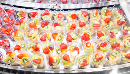 fruit salad arranged in plastic cups for sale showcase or buffet used in