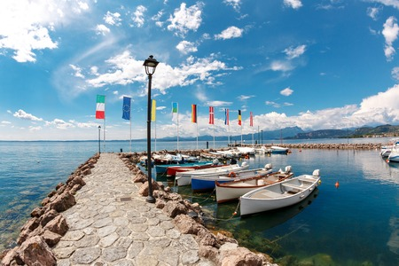 Summer morning on Lake Garda. Italy, Europe. It is located in NorthernItaly, about half-way between Brescia and Verona, and between Venice and Milan. Stock fotó