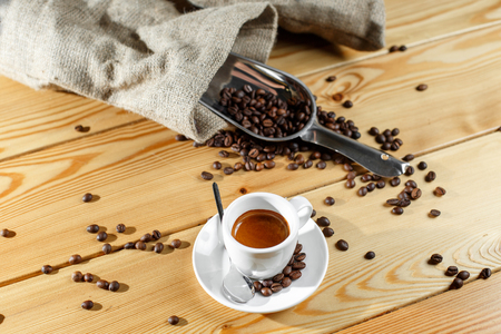 scattering: Coffee beans and coffee cup Stock Photo