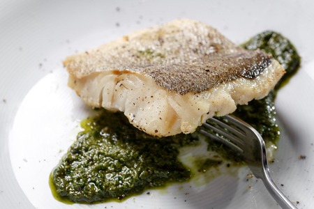 flavouring: Fried fish fillet, Atlantic cod with rosemary in white plate Stock Photo