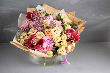 precast: the job of a florist. Vintage gray texture with empty space decorating by rose and mixed flowers sweet romantic concept