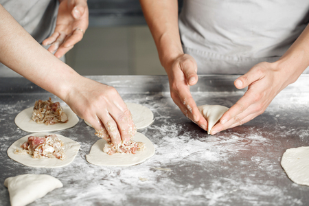 the Baker forms his own hands the billet of dough for baking Stock Photo
