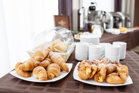 feast: Breakfast at the hotel. croissants and puff in the foreground. selective focus