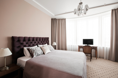 suite: Hotel apartment, bedroom interior in the morning