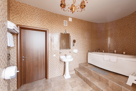 realestate: Modern luxury bathroom with bathtub and window. Interior design.