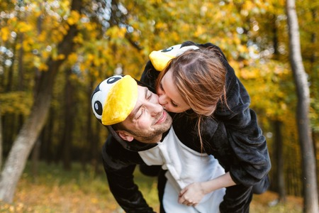 Couple in Matching Penguin Pajamas in autumn forest