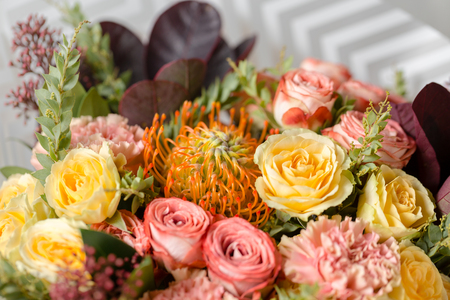 Flower composition on a gray background. Wedding and Festive decor. Bouquet from spring flowers. closeup