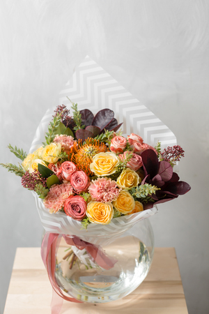 Flower composition on a gray background. Wedding and Festive decor. Bouquet from spring flowers. copy space