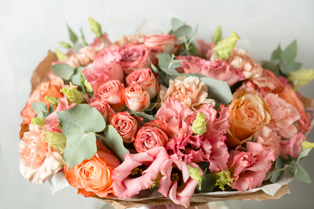 Flower composition on a gray background. Wedding and Festive decor. Powdery pink color.