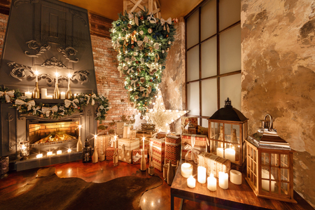alternative tree upside down on the ceiling. Winter home decor. Christmas in loft interior against brick wall. Imagens