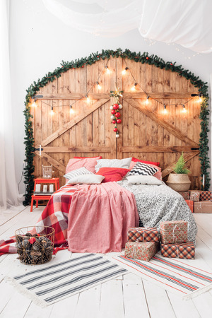 Xmas in morning bedroom. Double bed In christmas Interior on wood wall background