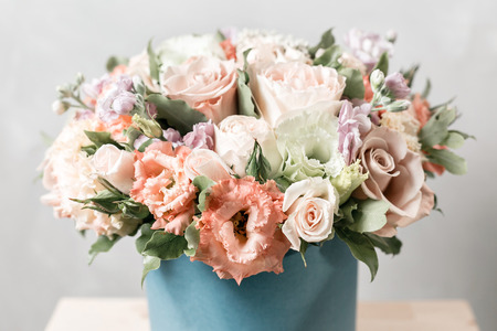 Luxury bouquets of mix flowers in the hat box. vintage color