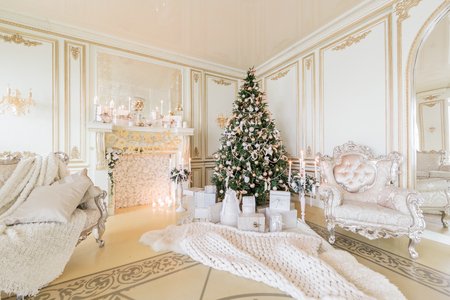 Christmas morning. luxury classic apartments with a white fireplace.