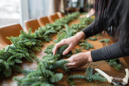florist at work woman hands making christmas decorations garland stock photo picture and royalty free image image 90844041 - Christmas Decorations For Work