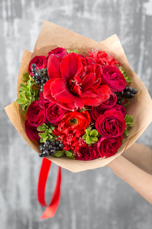 beautiful luxury bouquet of mixed flowers in woman hand. the work of the florist at a flower shop. Stock Photo