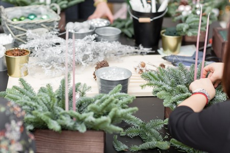 Workshop of Christmas decor with their own hands. Christmas wooden box with fir branches for the holiday. The new year celebration. Master class on making decorative ornaments Reklamní fotografie