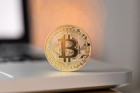 coin bitcoin on the laptop keyboard. the concept of trading cryptocurrency. The rapid growth of the currency.