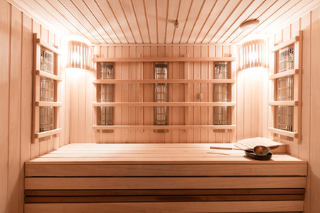 Interior of new Finnish sauna, infrared panels for medical procedures, classic wooden sauna.