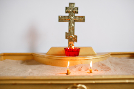 two candles and lamp close-up. Interior Of Orthodox Church In Easter. baby christening. Ceremony in Christian . bathing the into the baptismal font Foto de archivo