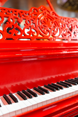 Vintage red classical grand piano. Black and white keys. Keyboard of antique key music instrument. Copy space Stock Photo