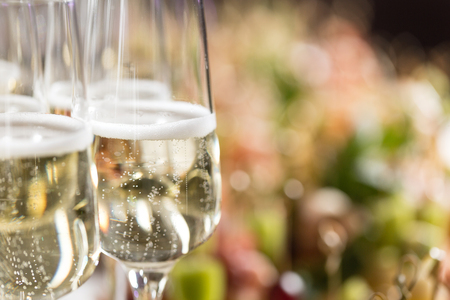 Furshet. Table top full of glasses of sparkling white wine with canapes and antipasti in the background. champagne bubbles Standard-Bild