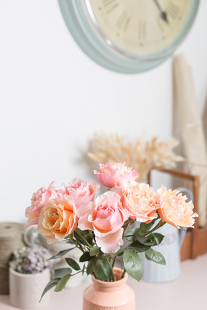 Bouquet flowers of pink roses in glass vase. Shabby chic home decor. florist at a flower shop.