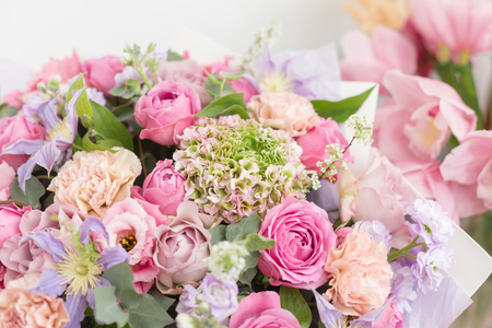 Close-up beautiful luxury bouquet of mixed flowers in glass vases. the work of the florist at a flower shop. Wallpaper