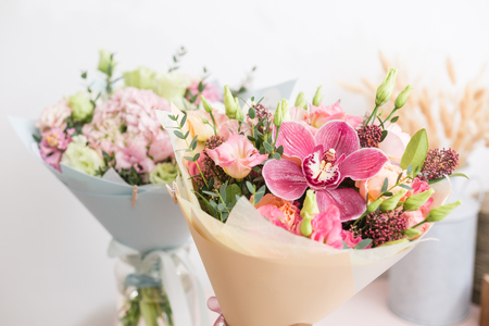 flower shop concept. Close-up beautiful lovely bouquet of mixed flowers on wooden table. Wallpaper