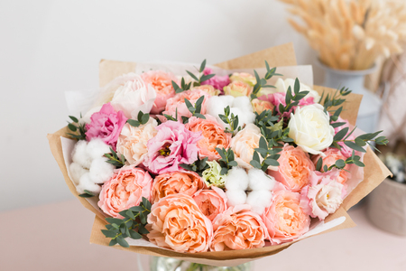 flower shop concept. Close-up beautiful luxury bouquet of mixed flowers on wooden table. Wallpaper