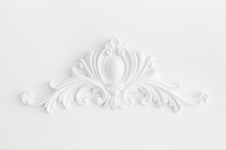 Expensive interior. Stucco elements on light luxury wall. White patterned. Mouldings element from gypsum. Roccoco style Stock fotó