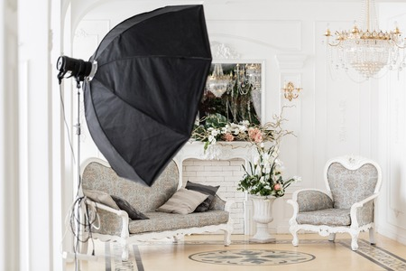 photographic studio with modern lighting equipment. Light spring room studio interior. Luxury decor with daylight. Stock Photo