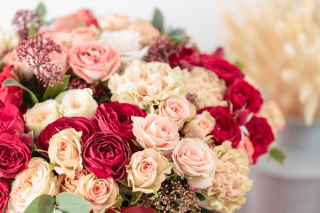 Beautiful luxury bouquet of mixed flowers in red box. the work of the florist at a flower shop. Wallpaper
