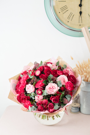 Beautiful luxury bouquet of mixed red and pink flowers in glass vases. the work of the florist at a flower shop. Wallpaper