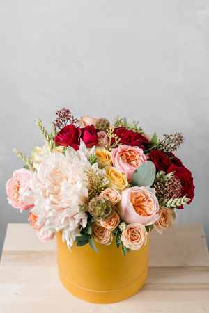 Luxury bouquet of mixed flowers in yelow paper headbox.