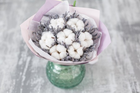 Bouquet of lavender and cotton flowers. Colorful summer bunch of purple lavender and white blossoms flowers. Фото со стока