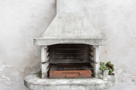 Smoky antique brick oven outdoor with ashes inside. Old garden heater. grill usable for BBQ. patio Vienna, Austria