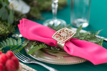 table setting. Wedding decor in the magic forest for a loving couple. Pink and green colors. Raspberry dessert.