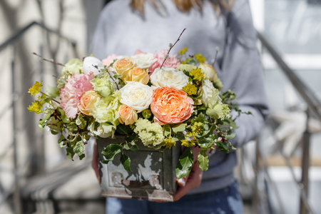 bouquet of beautiful flowers in womens hands. Floristry concept. Spring colors. the work of the florist at a flower shop Stock Photo