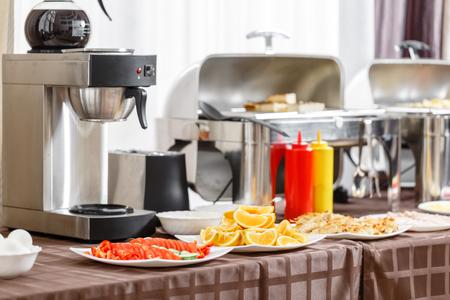 Buffet heated trays ready for service. Breakfast in hotel smorgasbord.