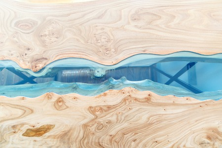 Texture of a wooden table with epoxy resin. Top view of wood for background Stockfoto