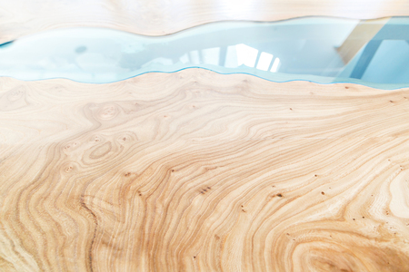 Texture of a wooden table with epoxy resin. Top view of wood for background Stock Photo
