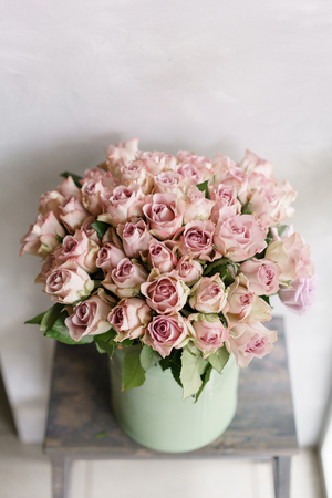 Roses of multicolor, pastel pink and lilac color. Lots of buds. Floral natural backdrop. Flower shop concept Archivio Fotografico