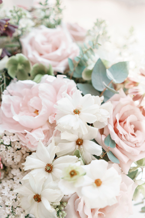 Wedding bouquet of white lilac, roses, peony and buttercup. Lots of greenery, modern asymmetrical disheveled bridal bunch. Spring flowers Stock Photo