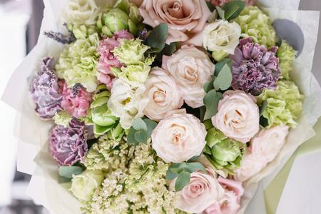 flower arrangement. multicolor bouquet of beautiful flowers on wooden table. Floristry concept. Spring colors. Vertical photo