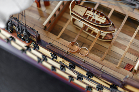 Wedding Rings on Wood model of the medieval ship. Bride and groom accessories. Maritime concept Reklamní fotografie