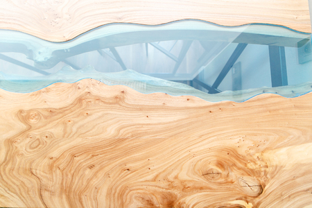 Top view of wood for background. Texture of a wooden table with epoxy resin. Stock Photo