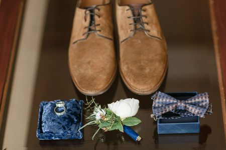 Two golden wedding rings laying on blue surface. accessories for the bride and groom. Preparation for the ceremony